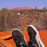 Me and my dusty shoes looking at Uluru