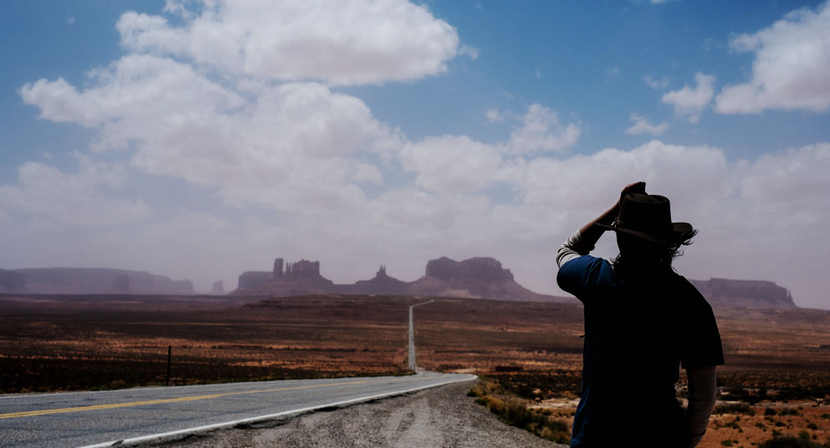 Charlene, sandstorm and the road to Monument Valley.