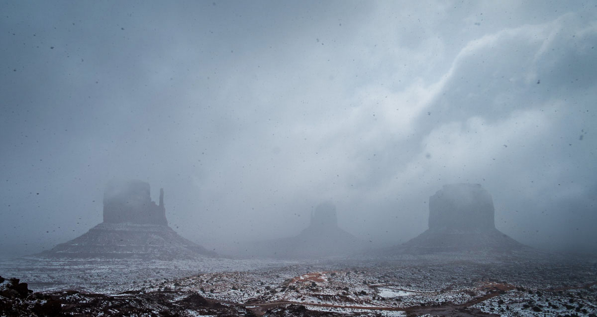 Monument Valley while a snow storm rages.