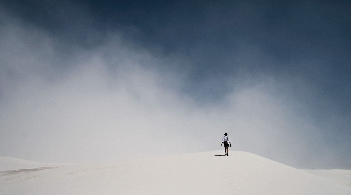 Charlene in a sandstorm in wide open spaces at White Sands, New Mexico.