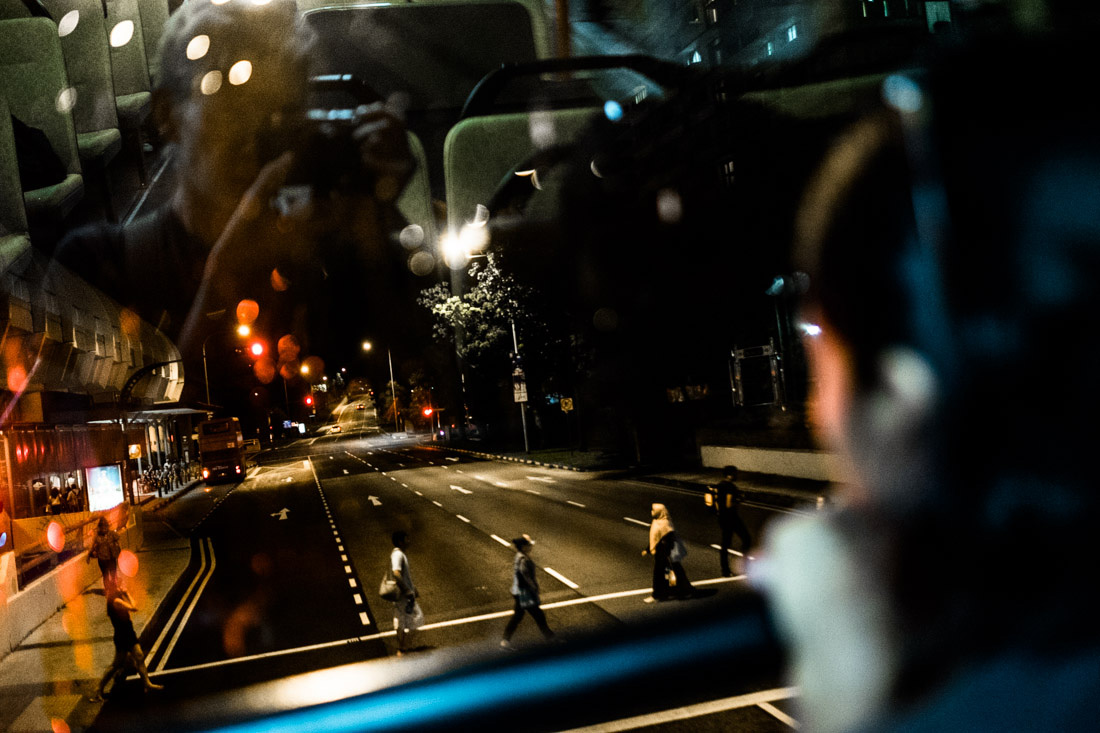 On the double decker bus at night