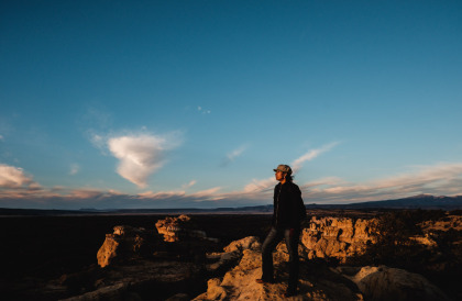 Charlene looking out over the grand El Malpais landscape in New Mexico.