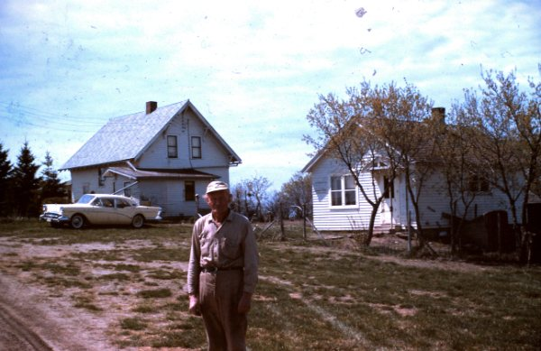 Carl in front of his house and the Damgaard house in Britton, South Dakota