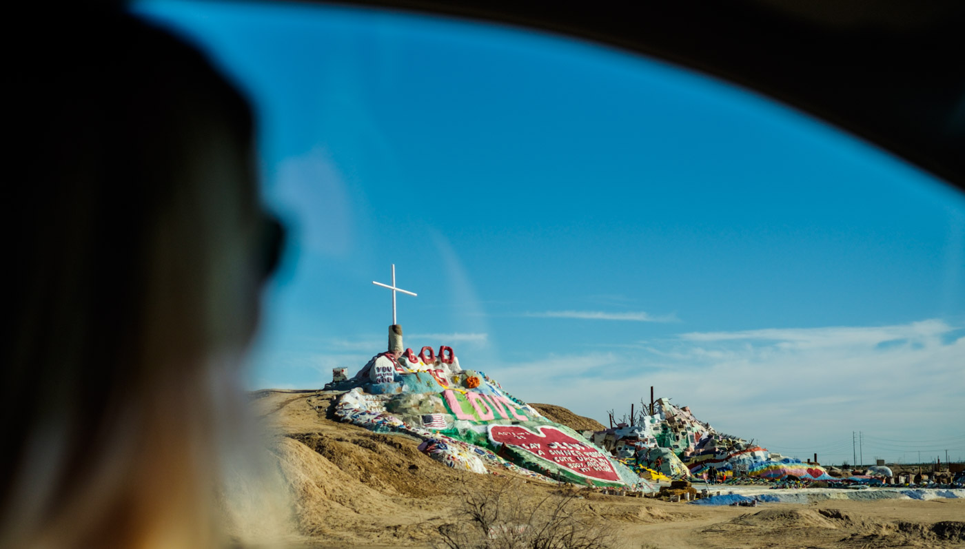 Salvation Mountain in California, my sister at the wheel.