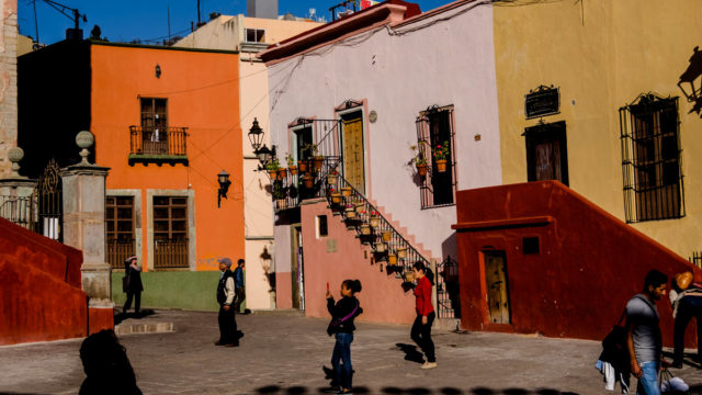 I really like this shot, there is so much going on, all these people doing strange things. And that is exactly what these buildings at Plaza de San Fernando looks like, it is like Fujichrome Velvia was applied to the whole city!