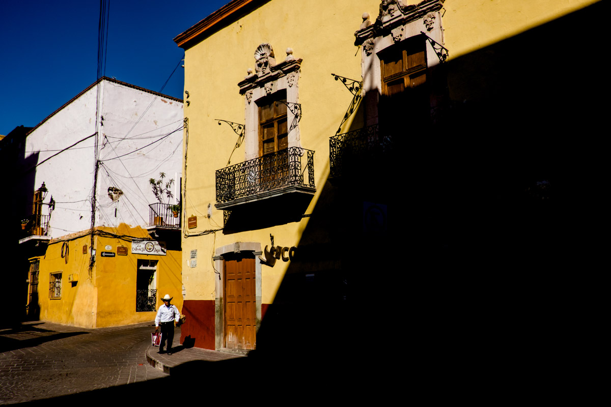 This street corner near the post office proved to be a great spot late in the afternoon. The sun in Guanajuato literally slices a place like this in two.