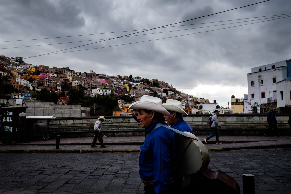 Most of the days in Guanajuato were sunny and sometimes quite warm, but for a few days we got massive storms and snow! Here's a few musicians on the way to work under a dark sky.