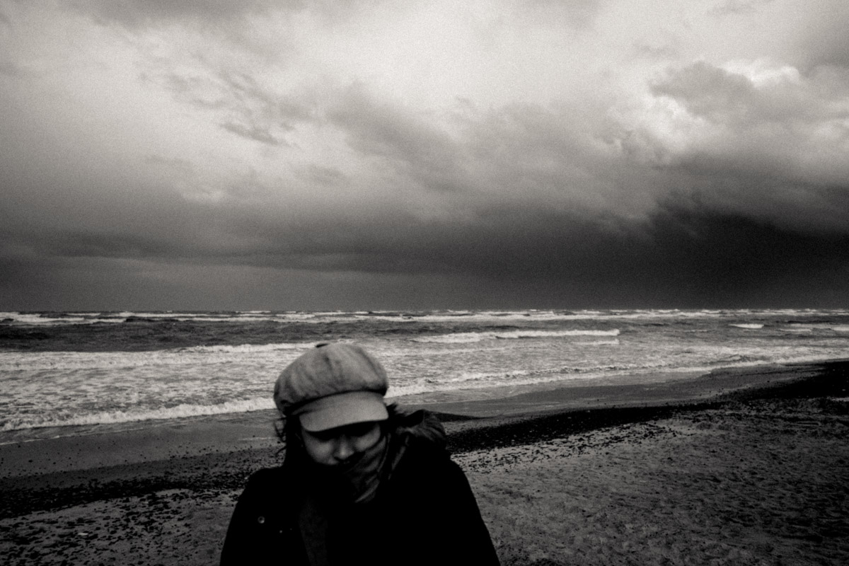 X-T2, the 18mm lens and a very cold Charlene at Thorup Beach as a storm front hits us.